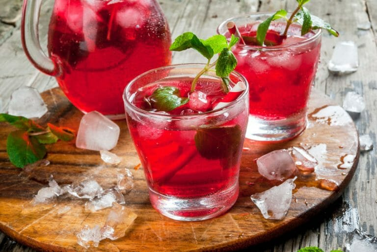 Hibiscus summer punch in glasses and in a pitcher